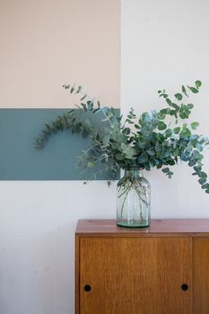 eucalyptus in vase on sideboard interiors